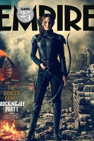 Дженнифер Лоуренс в образе Китнисс Эвердин на обложке журнала