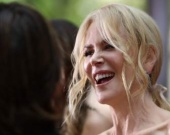 Nicole Kidman is happy in a soft way.